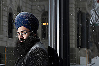 Balpreet Singh, lawyer at the World Sikh Organization of Canada, poses in front of the National Assembly in Quebec City Tuesday January 18, 2011. Singh was denied entrance by Quebec National Assembly security because he insisted on wearing ceremonial kirpans.