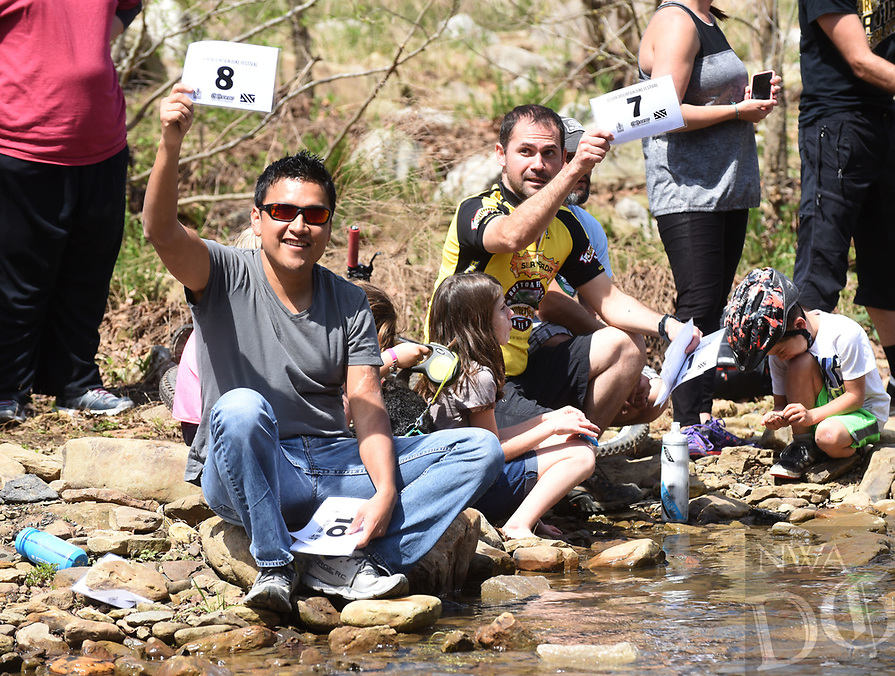 NWA Democrat-Gazette/FLIP PUTTHOFF <br /> BIG BIKE SPASH<br /> Ray Vega of Rogers (left) and Nick Biondi of Winslow score a bike rider's splash Saturday April 8 2017 during the Lee Creek Cannonball Big Splash Contest, part of the 29th annual Ozark Mountain Bike Festival at Devil's Den State Park. About a dozen contestants were judged on the size of their splash and style going into the water. Jeremiah &quot;Scratch&quot; Stone of Rogers won the contest. Festival events included guided mountain bike rides for all skill levels, clinics on riding technique, a poker run, bike games for kids and a cookout. The festival ends today with a guided ride at 10:30 a.m.