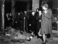 Citizens of Ludwigslust, Germany, inspect a nearby concentration camp under orders of the 82nd Airborne Division.  Bodies of victims of Nazi torture were found dumped in pits in yard, one pit containing 300 bodies.  May 6, 1945.  T4c. Jack Clemmer.  (Army)<br /> NARA FILE #:  111-SC-207193<br /> WAR &amp; CONFLICT BOOK #:  1123