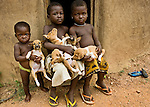 We were traveling through Benin when an adobe building caught our eye. We stopped to photograph it and suddenly some children trailed by puppies appeared. This image captures one of many serendipitous moments we encountered in our travels.