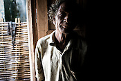 An old man sits inside his hut in the village that is few metres from the boundary wall of the refinery and causes obstruction of expansion as it falls inbetween the land that has already bought by Vedanta. The villagers are resisting and have decided not to sell the land to the company at any cost.