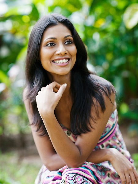 Portrait of smiling young Indian woman, Kairali Ayurvedic Health Resort, Palakkad, Kerala, India.
