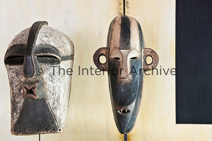 A pair of Congo masks featuring completely diferent shapes and expressions