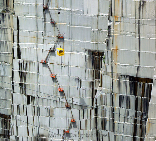 Face of the working rock wall with ladders and carriers in the Rock of ages Granite quarry, Barre Vermont, by Ano Lobb