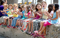 Children eat ice-cream at Santa Monica Ocean Front Walk during Outside the Box Creative Academy's summer camp field trip to the beach on Friday, August 12, 2011.