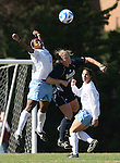 24 November 2007: North Carolina's Robyn Gayle (CAN) (11) and Notre Dame's Brittany Bock (10) challenge for a header as North Carolina's Jessica Maxwell (behind) watches. The University of Notre Dame Fighting Irish defeated University of North Carolina Tar Heels 3-2 at Fetzer Field in Chapel Hill, North Carolina in a Third Round NCAA Division I Womens Soccer Tournament game.