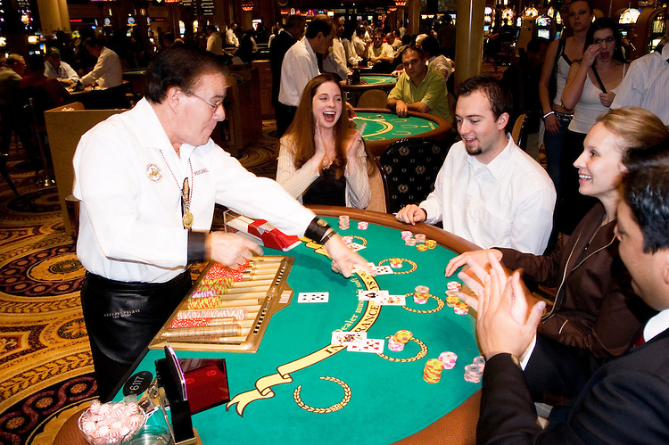 Blackjack table in Las Vegas, Nevada, Caesars Palace and Casino, gaming, gambling, chips, blackjack, betting croupier, blackjack players, model released, blackjack table, cards, NV, Las Vegas, Photo nv246-17159..Copyright: Lee Foster, www.fostertravel.com, 510-549-2202,lee@fostertravel.com