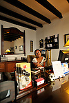 """The receptionist in a cozy hotel in  Antigua, Guatemala  during colorful and festive """"Semana Santa"""" (Saint week). ..Antigua, a colonial town, is a UNESCO World Heritage site."""