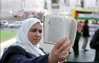 Roma  2004 .Manifestazione per la Palestina.Donna palestinese mostra il Corano.Rome 2004.Demonstration for Palestine.Palestinian woman shows the Koran.
