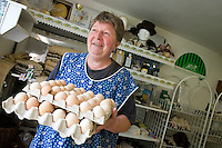Giant Mountains, Northern Bohemia, Czech Republic, June 2010. Anna Tumova runs a tiny shop out of her garage and is also the proud recordholder of knitting a sweater out of sheeps wool from sheering to the end product in 6 hours and 25 minutes. The area around Teplice, also known as the Broumovsky Steny, was inhabited by ethnic Sudeten Germans, that were deported after the Second World War. The rural landscape with green fields and cattle is dotted with little villages scarred by communist socialist architecture. Photo by Frits Meyst/Adventure4ever.com
