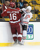 Alex Fallstrom (Harvard - 16), Mike Hewkin (Northeastern - 28) - The Northeastern University Huskies defeated the Harvard University Crimson 4-0 in their Beanpot opener on Monday, February 7, 2011, at TD Garden in Boston, Massachusetts.