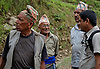 Ram Kumar Bhandari speaking with road workers near his home village in Besishahar Lamjung.