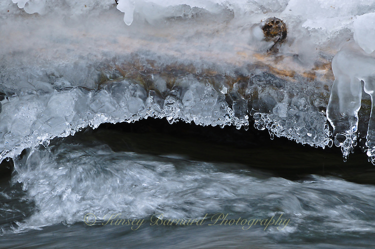 &quot;BRIDGE&quot;<br /> <br /> An ice bridge formed over a creek<br /> <br /> Ice formations along a river's edge creating intricate and beautiful designs