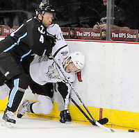 San Antonio Rampage's Mark Cullen, right, fights Milwaukee Admirals' Scott Ford for the puck during the second period of an AHL hockey game, Tuesday, April 10, 2012, in San Antonio. (Darren Abate/pressphotointl.com)