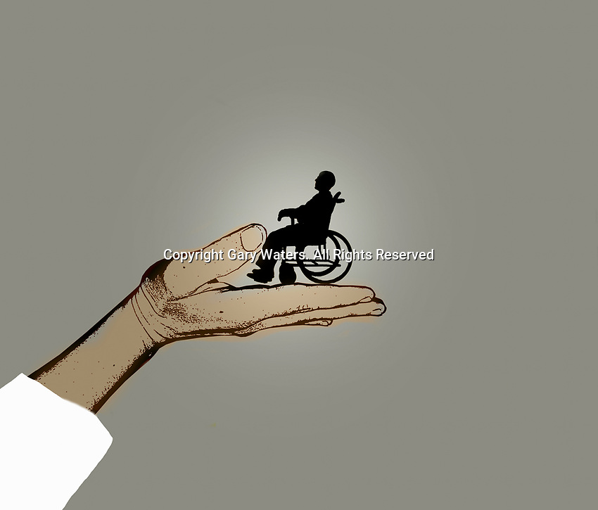 Hand supporting man in wheelchair