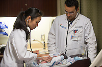 St. Mary's Medical Center. Emmanouil Tsounias, M.D., right, and Jocelyn Hu, class of 2014, infant, release 20120524006.