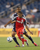 Toronto FC forward Joao Plata (7) traps the ball as New England Revolution defender Darrius Barnes (25) pressures. In a Major League Soccer (MLS) match, the New England Revolution tied Toronto FC, 0-0, at Gillette Stadium on June 15, 2011.