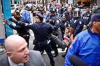 An Occupy Wall Street member is detained by NYPD officers during a  march against police brutality in New York, United States. 24/03/2012.  Photo by Eduardo Munoz Alvarez / VIEWpress.