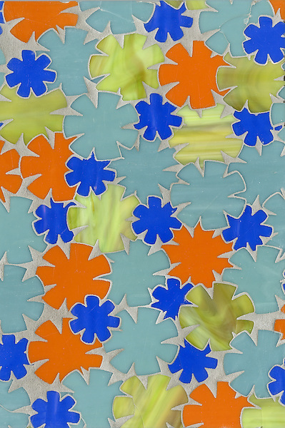 Flowers, a waterjet glass mosaic shown in Peridot, Serpentine, Athos and Stella, is part of the Erin Adams Collection for New Ravenna Mosaics.