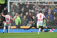 Stoke City's Jonathan Walters beats Chelsea's Thibaut Courtois from the penalty spot<br /> <br /> Photographer Mick Walker/CameraSport<br /> <br /> The Premier League - Stoke City v Chelsea - Saturday 18th March 2017 - bet365 Stadium - Stoke<br /> <br /> World Copyright &copy; 2017 CameraSport. All rights reserved. 43 Linden Ave. Countesthorpe. Leicester. England. LE8 5PG - Tel: +44 (0) 116 277 4147 - admin@camerasport.com - www.camerasport.com
