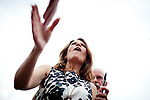 Republican presidential candidate, Rep. Michele Bachmann greets spectators at a campaign stop held at a Pizza Ranch in Newton, Iowa, August 5, 2011.