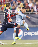 Sporting Kansas City substitute forward Dom Dwyer (14) follows through on a shot.  In the first game of two-game aggregate total goals Major League Soccer (MLS) Eastern Conference Semifinal series, New England Revolution (dark blue) vs Sporting Kansas City (light blue), 2-1, at Gillette Stadium on November 2, 2013.