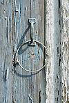 Detail of peeling paint on wood door.