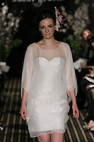 Model walks runway in an Aspire wedding dress by Sarah Jassir, for the Sarah Jassir Fall 2011 - Desire bridal collection.