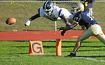 Beacon, NY - Poughkeepsie running back Josh Graham dives across the goal line after losing control of the ball in front of Beacon's Angelo Perrucci during a high school football game on Saturday, Oct. 10, 2009. Graham scored a touchdown on the play.