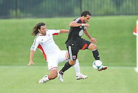Dwayne De Rosario (7) of D.C. United goes against Juan Toja (7) of the New England Revolution. D.C. United defeated the The New England Revolution 3-1 in the Quarterfinals of Lamar Hunt U.S. Open Cup, at the Maryland SoccerPlex, Tuesday June 26 , 2013.