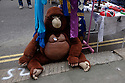 A stuffed toy gorilla sits on a market stall in St Leonards.