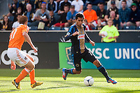 Josue Martinez (17) of the Philadelphia Union is marked by Andre Hainault (31) of the Houston Dynamo. The Philadelphia Union defeated the Houston Dynamo 3-1 during a Major League Soccer (MLS) match at PPL Park in Chester, PA, on September 23, 2012.