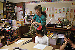 Oakland CA Teacher introducing 3rd gr. students to properties of exotic plants in class