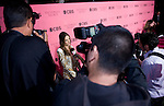 Photographers surround Victoria's Secret Angel Alessandra Ambrosio as she talks to the press before the start of 2011 Victoria's  Secret Fashion Show viewing party at the Samueli Theater at the Segerstrom Center of the Arts.
