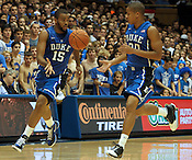 "Duke's Josh Hairston (15) passes the ball to teammate Andre Dawkins (20). Duke men's basketball had an opening scrimmage game as a part of the ""Countdown to Craziness"" event at Cameron Indoor Stadium Friday Oct. 14, 2011.  Photo by Al Drago..."