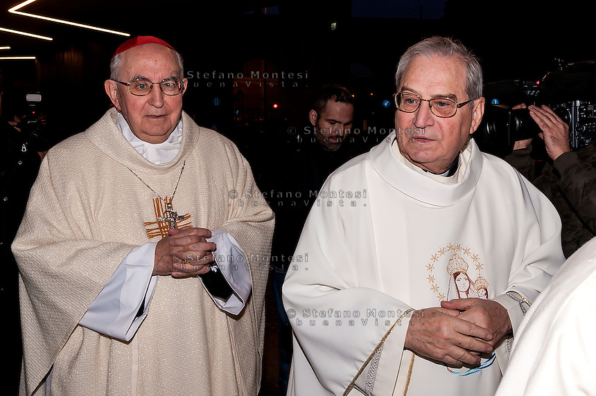 "ROME, ITALY -  DECEMBER 24:  Cardinal Pope's vicar for the Diocese of Rome, Agostino Vallini with Mons. Enrico Feroci director of Caritas Rome during  Christmas Mass at the hostel ""Don Luigi Di Liegro"" to Termini Station, with the  guests of Caritas on December 24, 2016 in Rome, Italy. (Photo by Stefano Montesi/Corbis via Getty Images)"