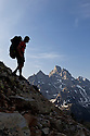WY00629-00...WYOMING - Backpacker above Lake Solitude near Paintbrush Divide in Grand Teton National Park.