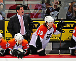 7 December 2009: Philadephia Flyers' newly appointed Head Coach Peter Laviolette looks out from behind the bench during a game against the Montreal Canadiens on his birthday at the Bell Centre in Montreal, Quebec, Canada. The Canadiens defeated the Flyers 3-1. Mandatory Credit: Ed Wolfstein Photo