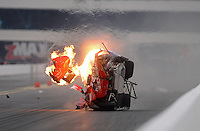 Sept. 16, 2012; Concord, NC, USA: NHRA pro stock driver Shane Gray goes airborne on fire as he crashes during the O'Reilly Auto Parts Nationals at zMax Dragway. Gray would be uninjured. Mandatory Credit: Mark J. Rebilas-