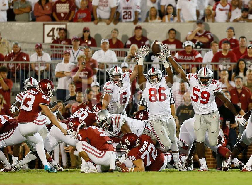 Ohio State Buckeyes defensive lineman Tyquan Lewis (59), defensive lineman Dre'Mont Jones (86) and defensive end Sam Hubbard (6) leap as Oklahoma Sooners place kicker Austin Seibert (43) misses a field goal during the first quarter of the NCAA football game at Memorial Stadium in Norman, Oklahoma on Sept. 17, 2016. (Adam Cairns / The Columbus Dispatch)