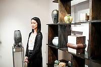 A woman watches pieces of art at Beatrice Lei Chang's gallery during the Asian Art Week in New York. 11.03.2015. Eduardo MunozAlvarez/VIEWpress.