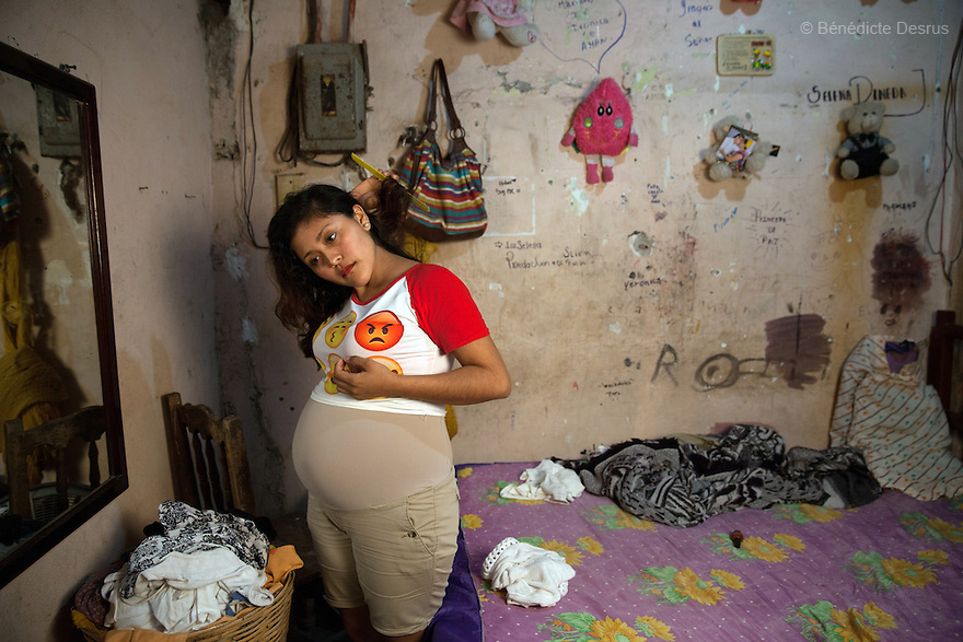 """Luz Selena Pineda Juan at her home in Juchitán, Oaxaca, Mexico on February 16, 2016. Luz is 16-year-oldand is seven months pregnant. The daughter of a local evangelical church representative, who refused to allow her out to teenage parties, she lives at home with her family in a working-class neighbourhood of Juchitán in the southern Mexican state of Oaxaca. Though she knows about contraception, she did not use it - she became pregnant after forgetting to take the morning-after pill. Her baby's father was married but has left his wife and 3-year-old daughter and Luz hopes they will be able to get married one day. She dropped out of school even before becoming pregnant and has no firm plans for her future. She is going to call her baby """"Soid"""" – the Spanish word for God, spelled backwards. While Mexico has outlawed marriage under the age of 18, many young girls become unofficial wives and mothers much earlier. In Juchitán, teenage pregnancy is expected, even prized. Mexico ranks first in teenage pregnancies among the member countries of the Organization for Economic Co-operation and Development(OECD). Photo by Bénédicte Desrus"""