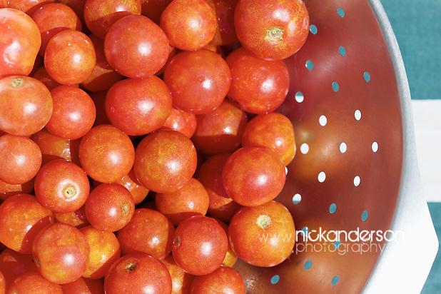 Freshly-picked cherry tomatoes, home grown in Cyprus, in a metal colander (Nick Anderson)