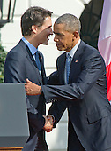 Prime Minister Justin Trudeau of Canada, left, shakes hands with United States President Barack Obama, right, listens during an Arrival Ceremony on the South Lawn of the White House in Washington, DC on Thursday, March 10, 2016. <br /> Credit: Ron Sachs / CNP