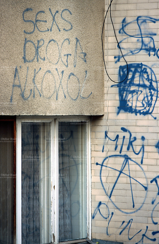 Kosovo. Pristina. Graffiti on a wall. Sex, drugs, alcohol, anarchism... © 2001 Didier Ruef