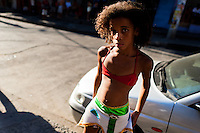 A Brazilian girl, wearing a colorful skirt, takes part in the Carnival parade in the favela of Rocinha, Rio de Janeiro, Brazil, 20 February 2012. Rocinha, the largest shanty town in Brazil and one of the most developed in Latin America, has its own samba school called GRES Academicos da Rocinha. The Rocinha samba school is very loyal to its neighborhood. Throughout the year, the entire community actively participate in rehearsals, culture events and parades related to the carnival.