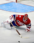22 March 2010: Montreal Canadiens' goaltender Jaroslav Halak dives to clear the puck during the first period against the Ottawa Senators at the Bell Centre in Montreal, Quebec, Canada. The Senators shut out the Canadiens 2-0 in their last meeting of the regular season. Mandatory Credit: Ed Wolfstein Photo