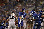 UK quarterbcak Mike Hartline throws a pass against Auburn in the second half at Commonwealth Stadium on Saturday, Oct. 9, 2010. Photo by Scott Hannigan | Staff