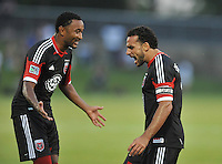 Dwayne DeRosario (7) of D.C. United celebrates with team mate James Riley (2) his score. D.C. United defeated the The New England Revolution 3-1 in the Quarterfinals of Lamar Hunt U.S. Open Cup, at the Maryland SoccerPlex, Tuesday June 26 , 2013.
