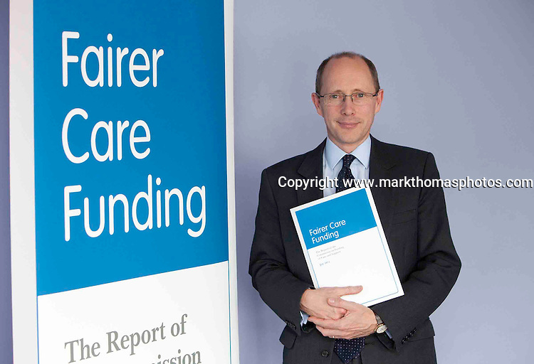 Andrew Dilnot gives his report -The commissionon Fundingof care and support on July 4th at the Q E 2 Conference centre,Westminster